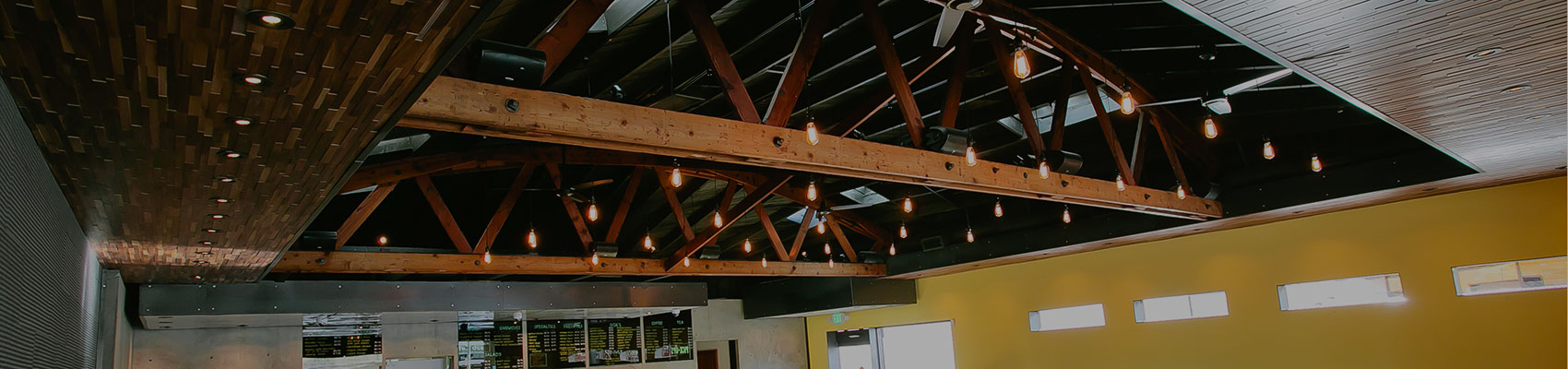 Gallery header image exposed wood ceiling